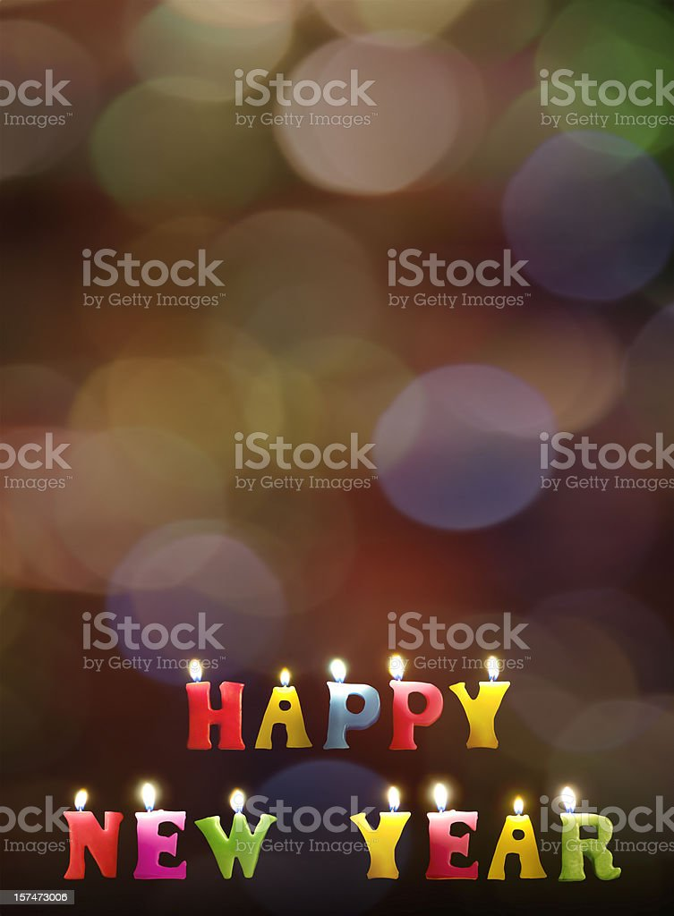 Colorful Happy New Year candles on rainbow bokeh background royalty-free stock photo