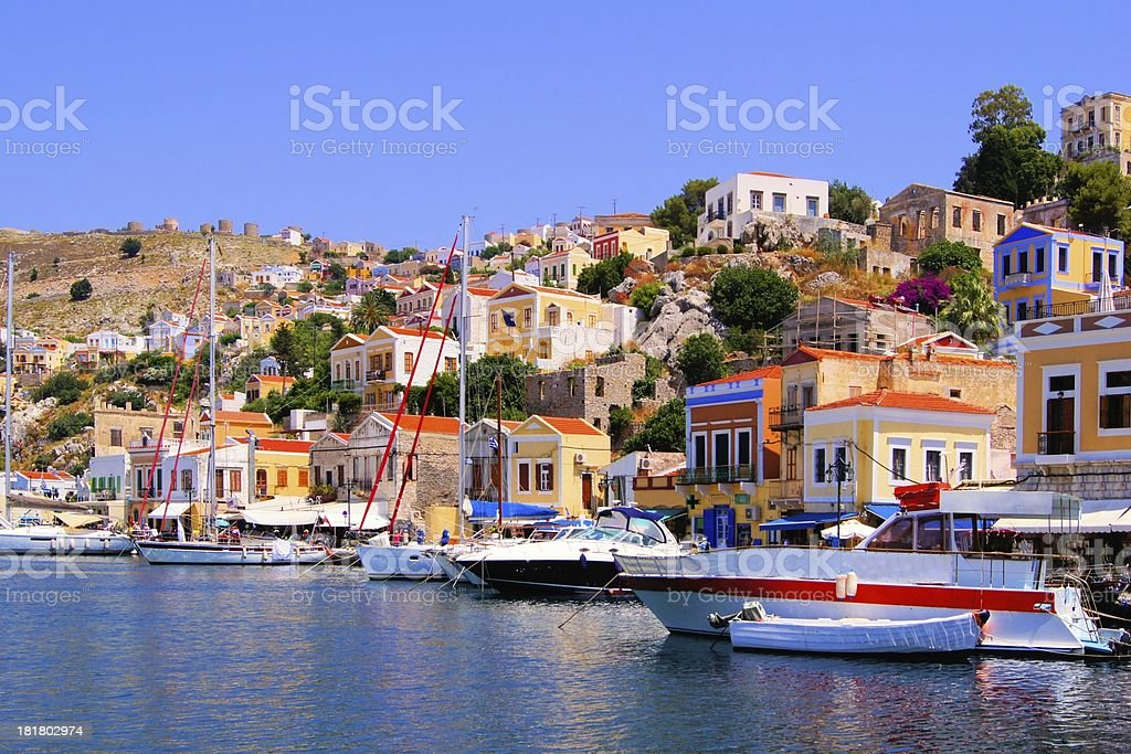 Colorful harbor with boats at Symi, Greece stock photo