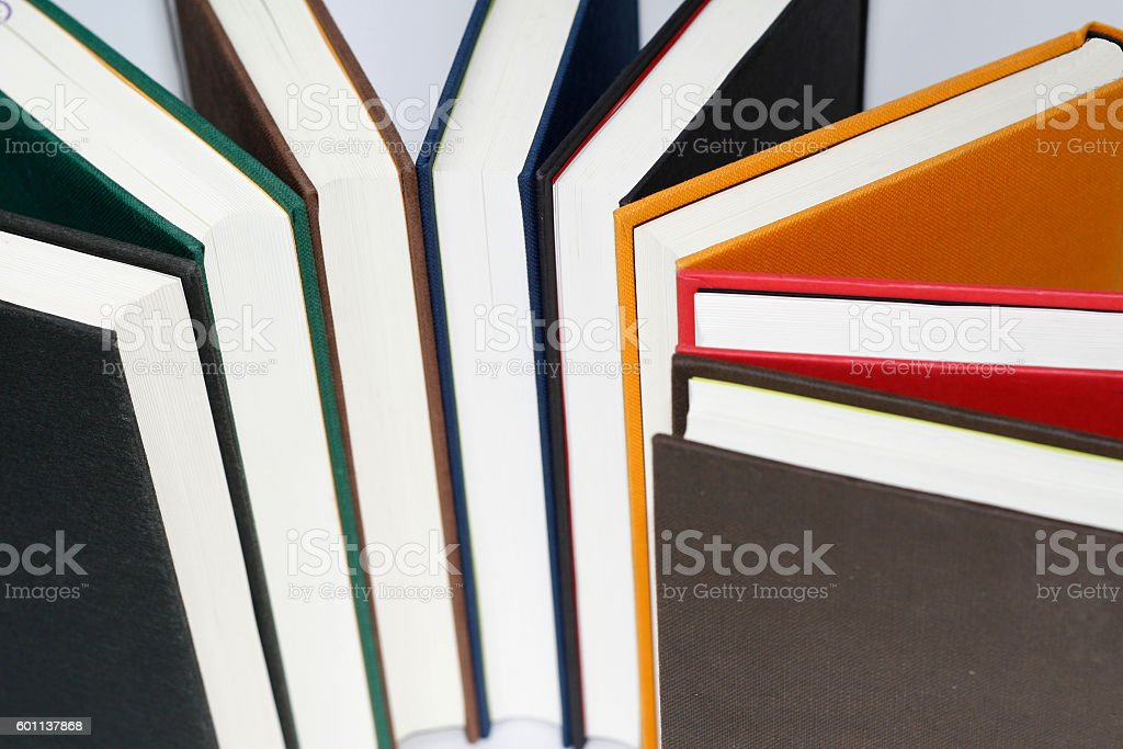 colorful hardback books seen from above stock photo