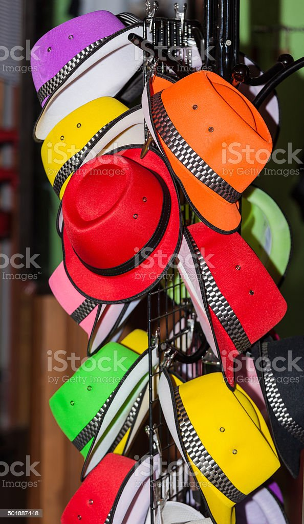 Colorful hat rack at a market stock photo
