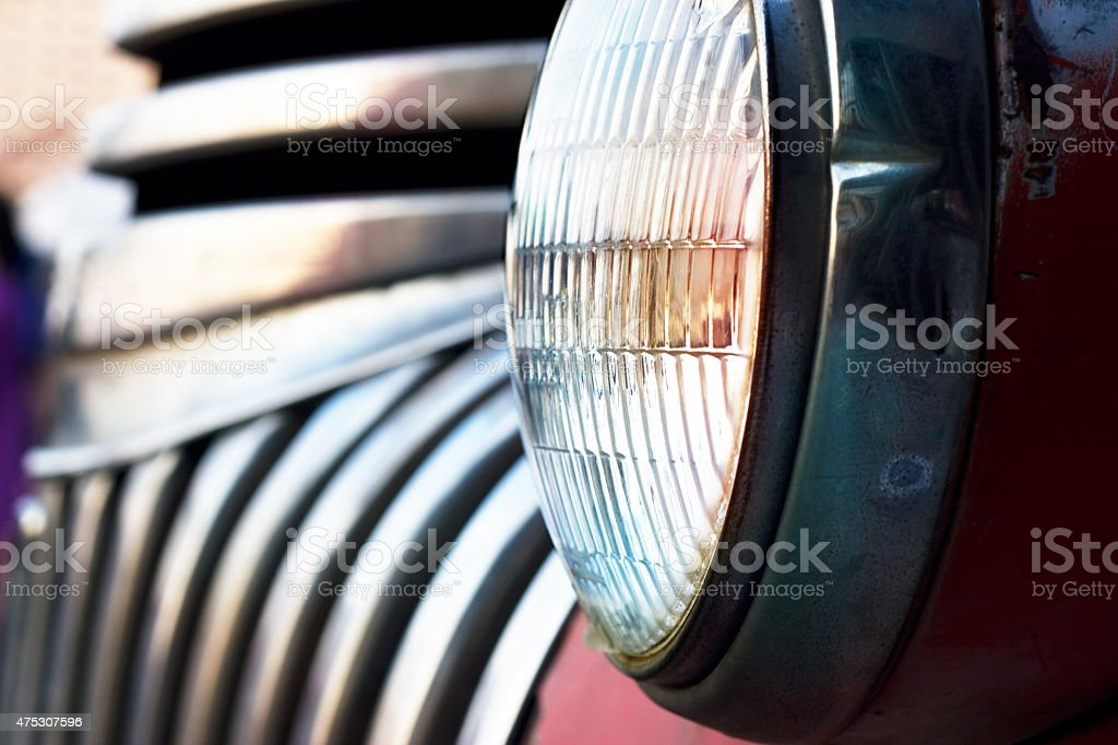 Colorful head light vintage car on dark tone, soft focus stock photo