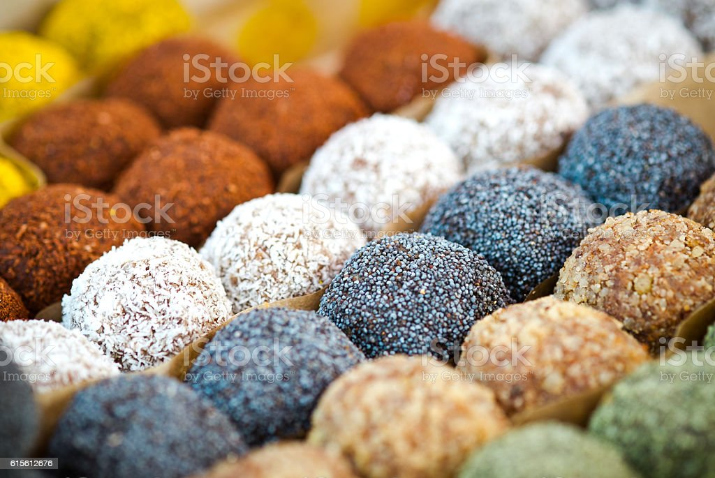 Colorful healthy homemade candies with nuts, dry fruits and spices stock photo