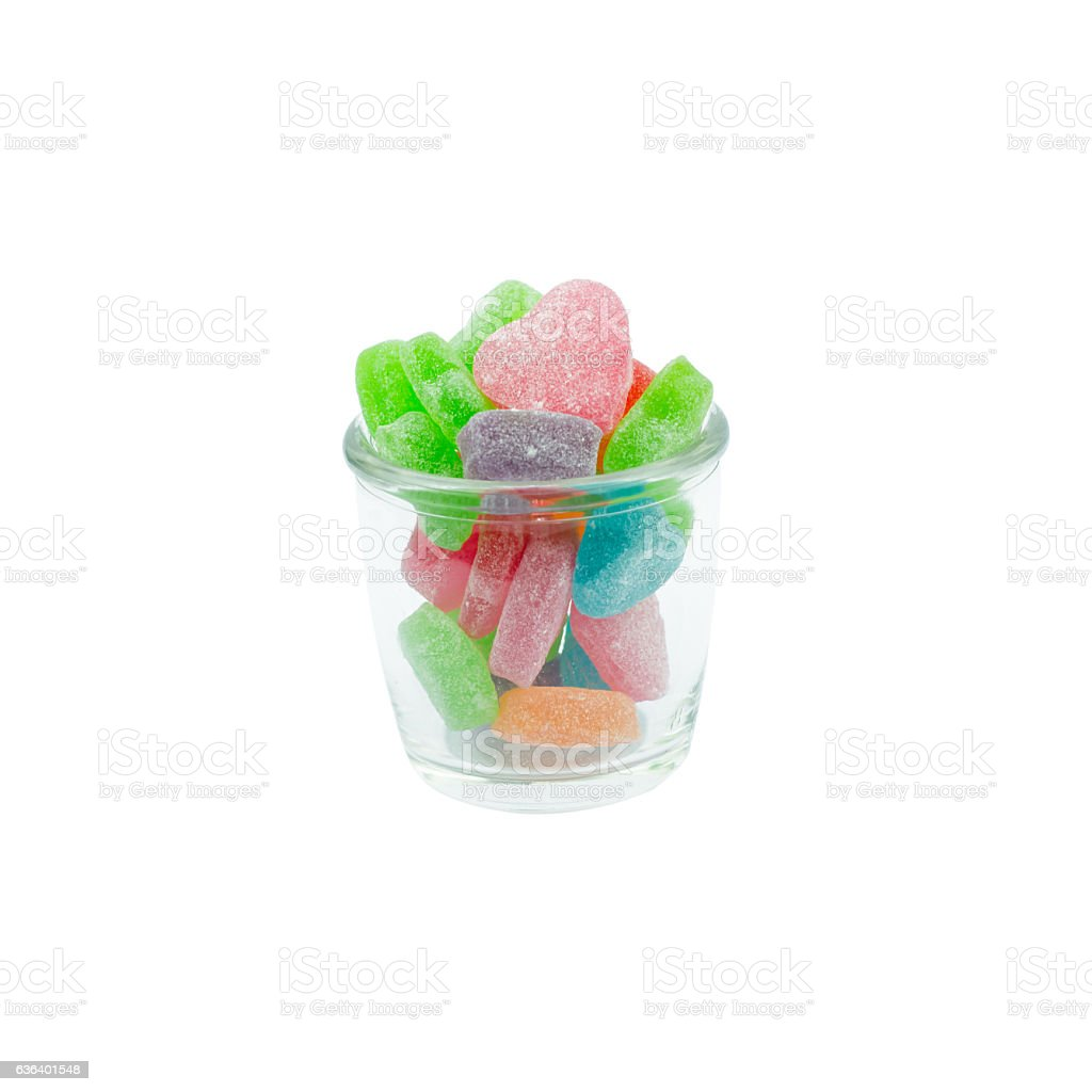 Colorful heart shape jellys in glass isolated on white backgroun stock photo