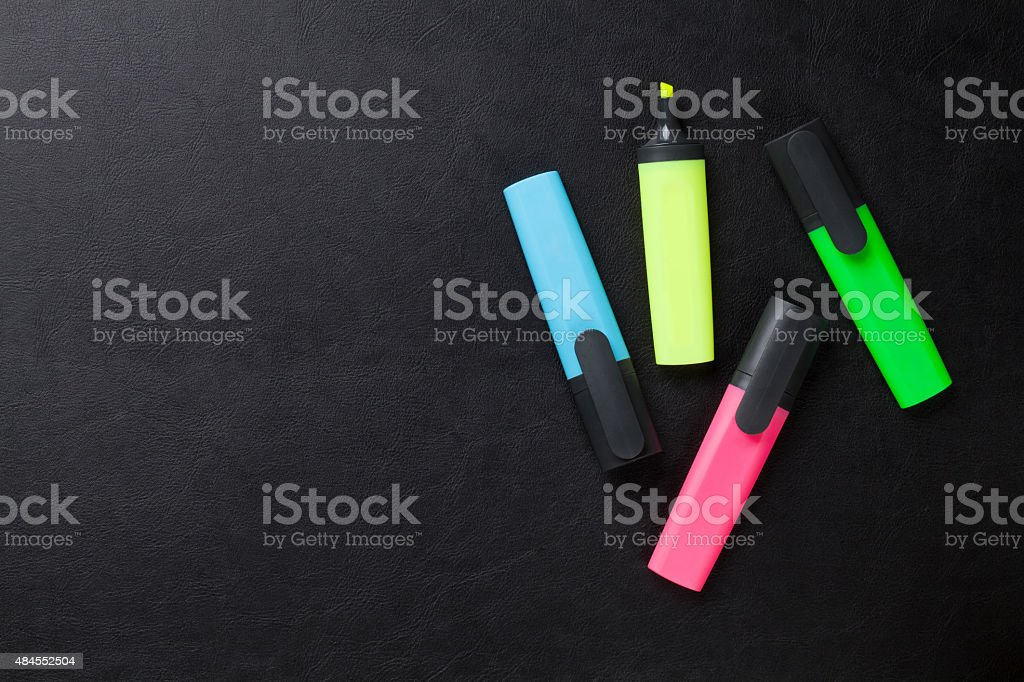 Colorful highlighters on desk stock photo