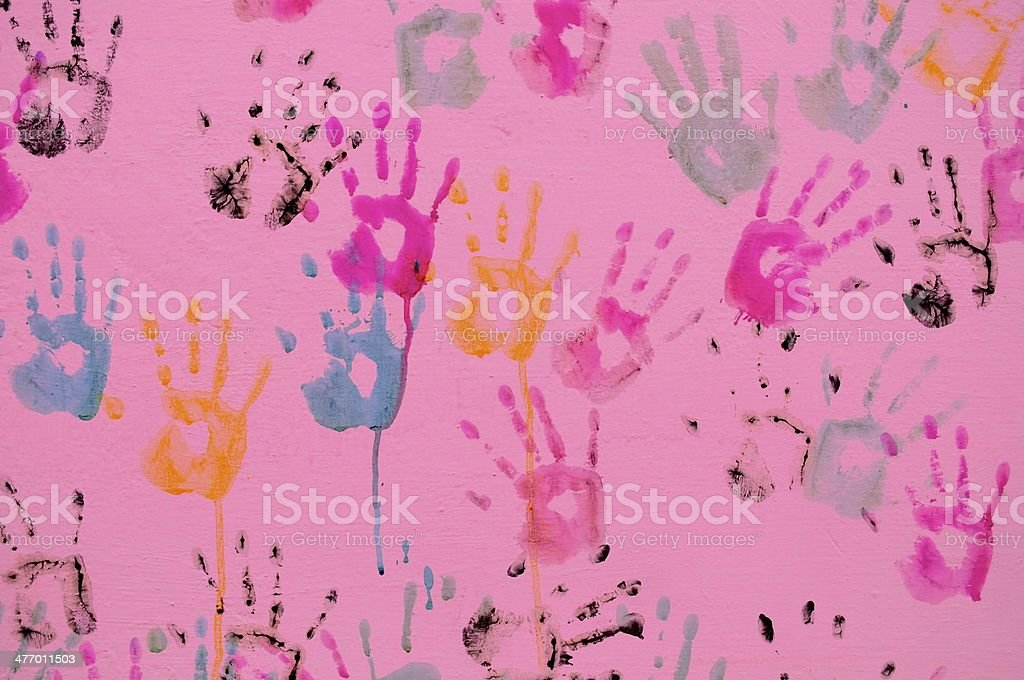 Colorful Holi background with hand prints and paint splashes. stock photo