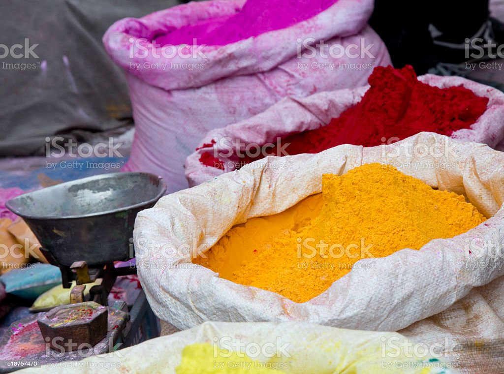 Colorful Holi powders at market stall stock photo