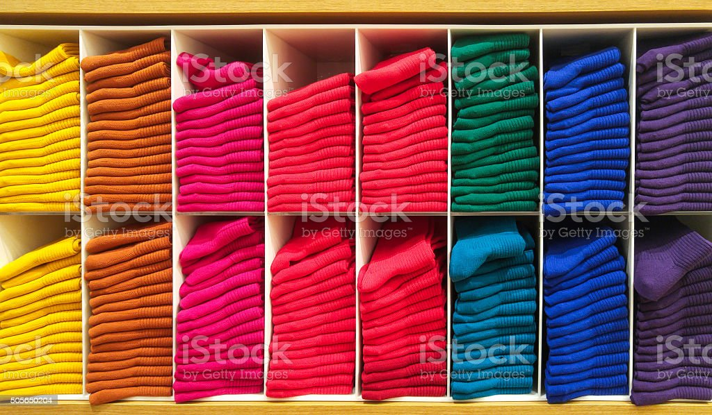 Colorful Horizontal Various Fluffy Bathing Towels on Wooden Shelf stock photo