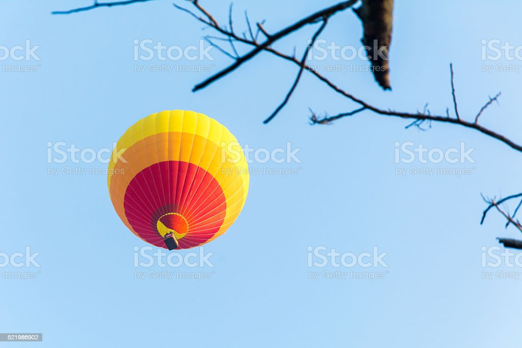 Colorful hot air balloon is flying. stock photo