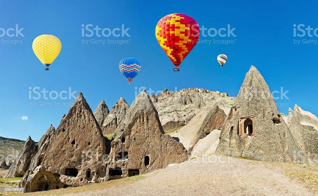 Colorful hot air balloons flying, Cappadocia, Anatolia, Turkey. stock photo