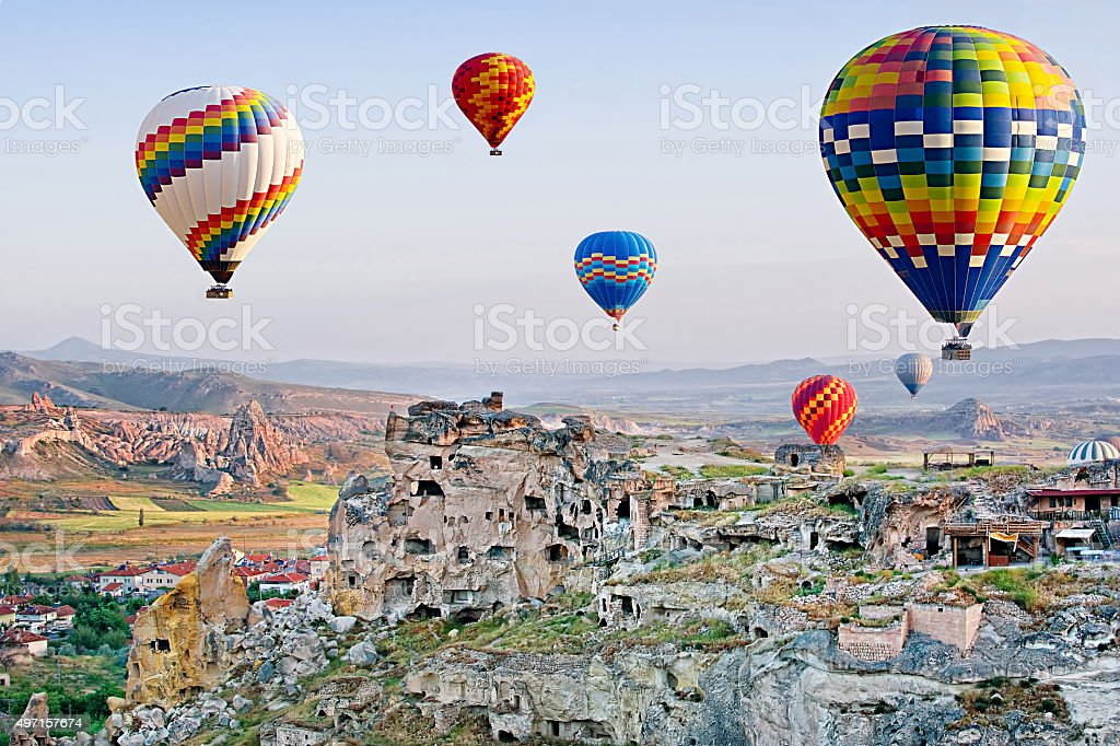 Colorful hot air balloons flying over Cavusin at Cappadocia,Turkey stock photo