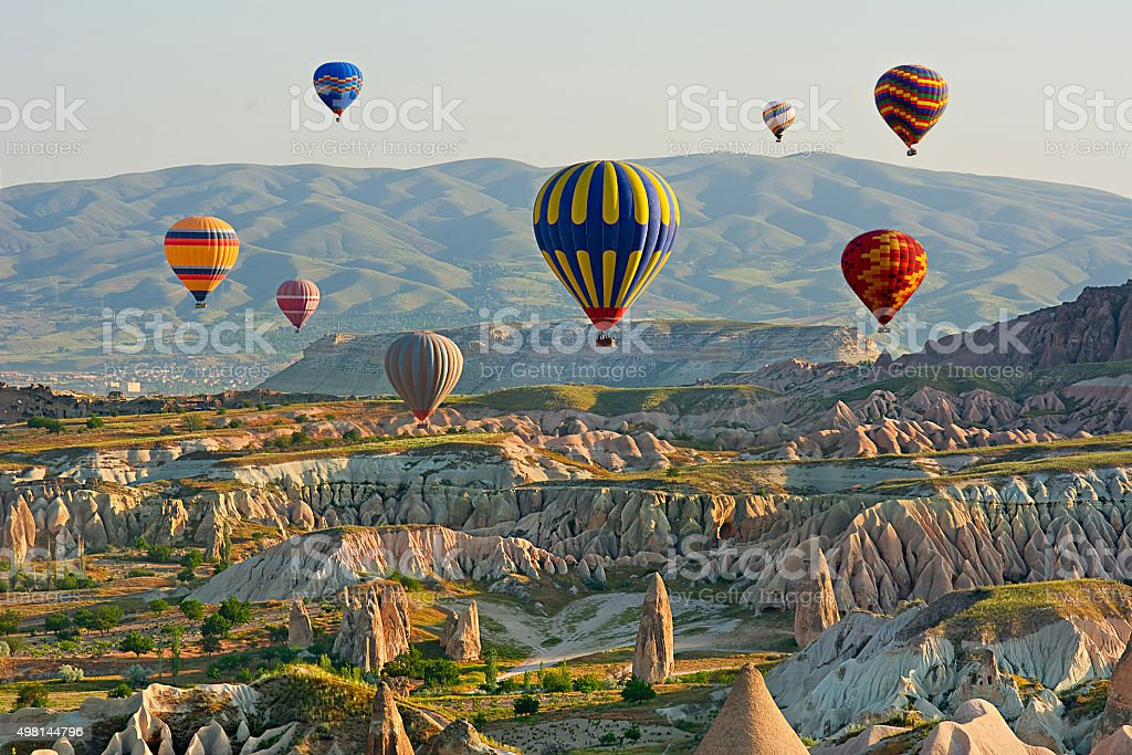 Colorful hot air balloons flying over the valley at Cappadocia, stock photo