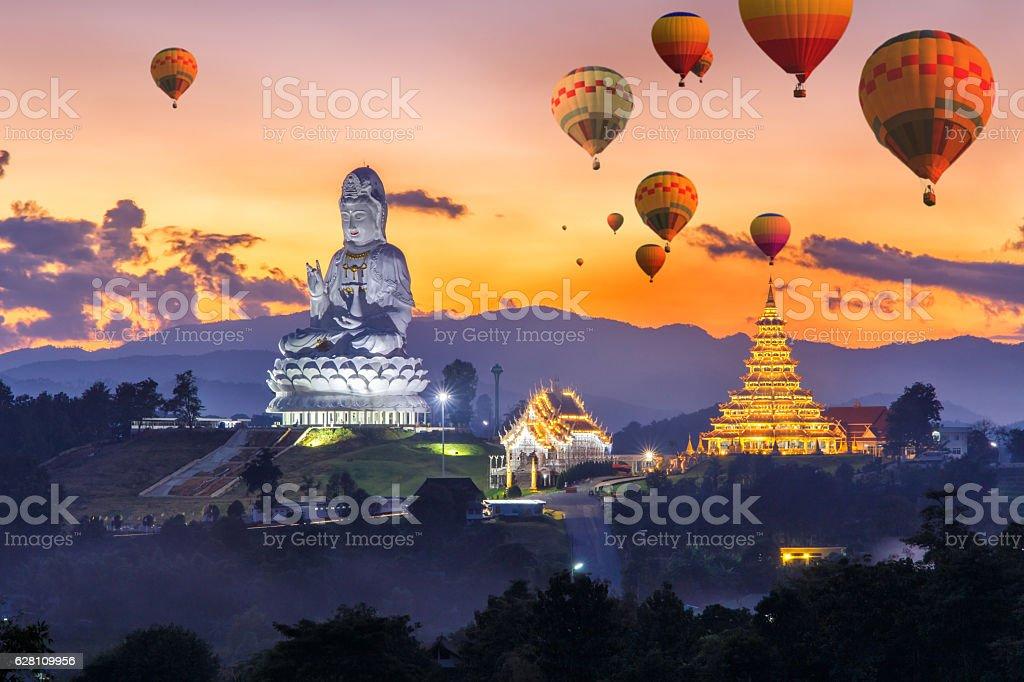 Colorful hot air balloons flying over Wat Huay Pla Kang stock photo