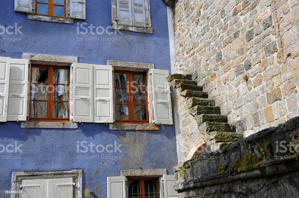 Colorful house and strange stairs on wall stock photo