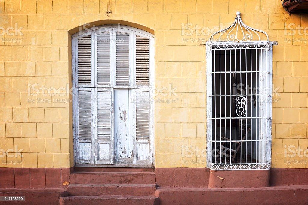 Colorful house facade in a street of Trinidad, Cuba stock photo