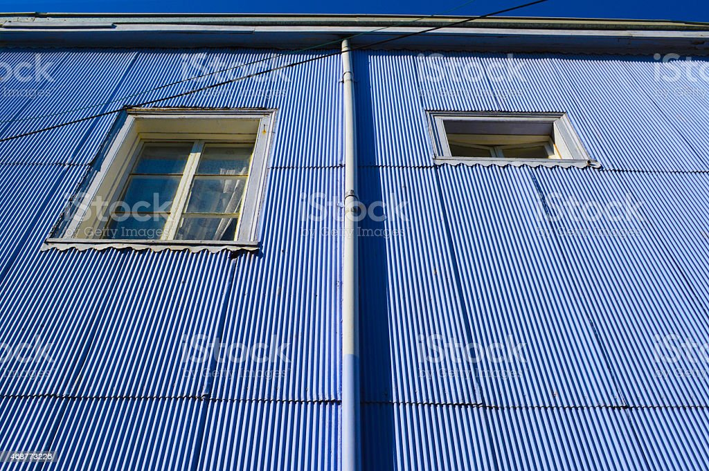 Colorful house with two windows in valparaiso stock photo