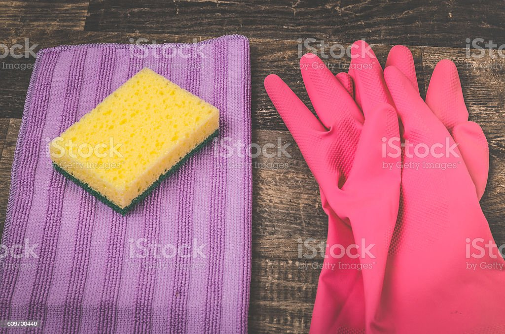 Colorful housekeeping equipment on a rustic wooden table stock photo