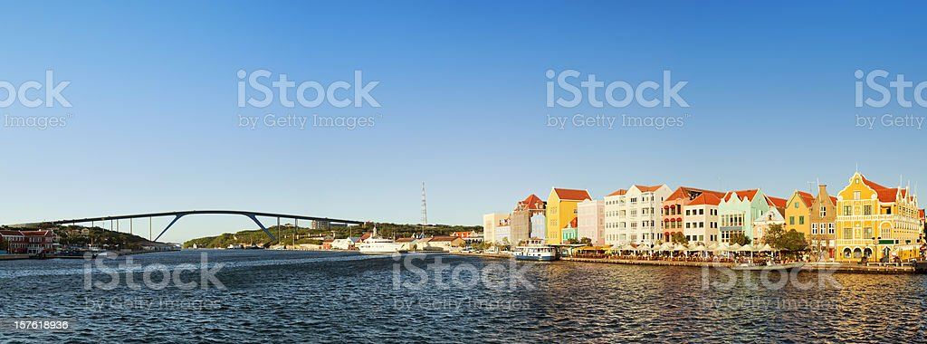 Colorful houses and Queen Juliana Birdge, Willemstad, Curaçao at sunset stock photo