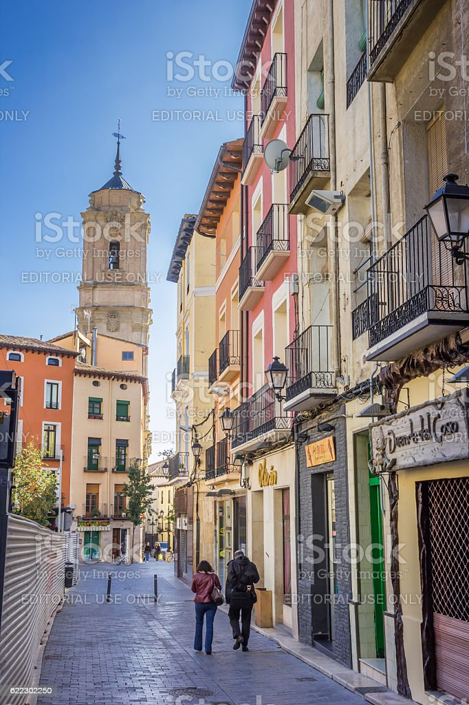 Colorful houses and San Lorenzo church in Huesca stock photo