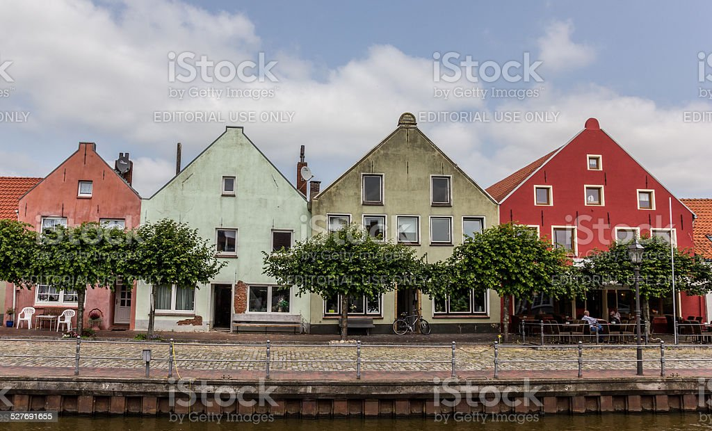 Colorful houses at the old harbor of Weener stock photo