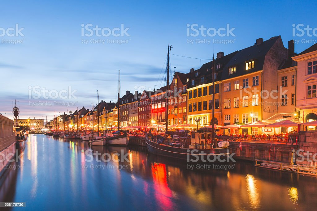 Colorful houses in Copenhagen old town at night stock photo
