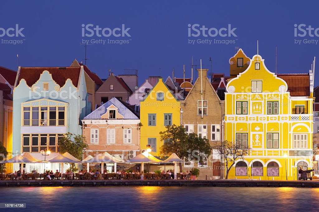 Colorful houses of Willemstad, Curaçao at night stock photo
