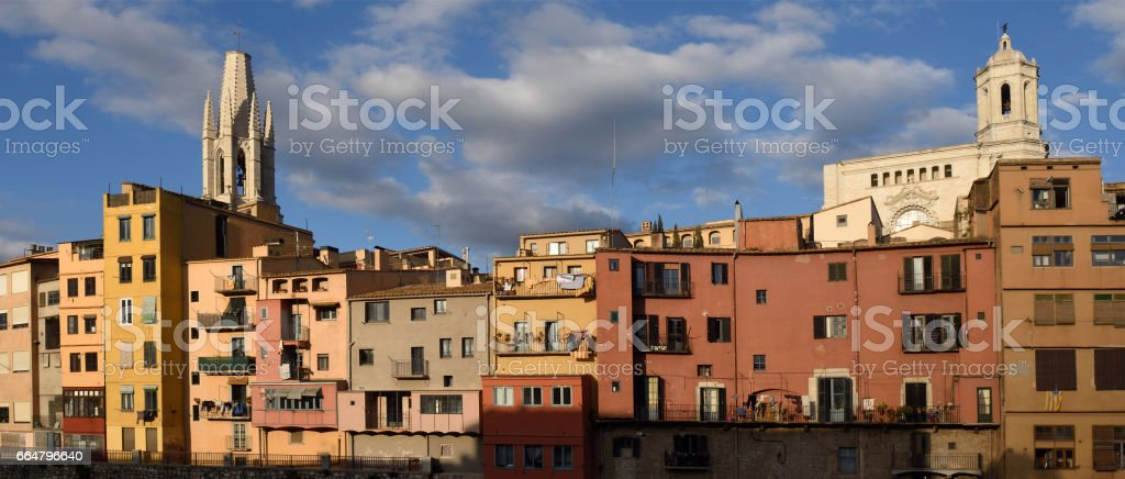 Colorful houses on the river Onyar and church of Sant Feliu and Cathedral, Girona, Catalonia, Spain stock photo