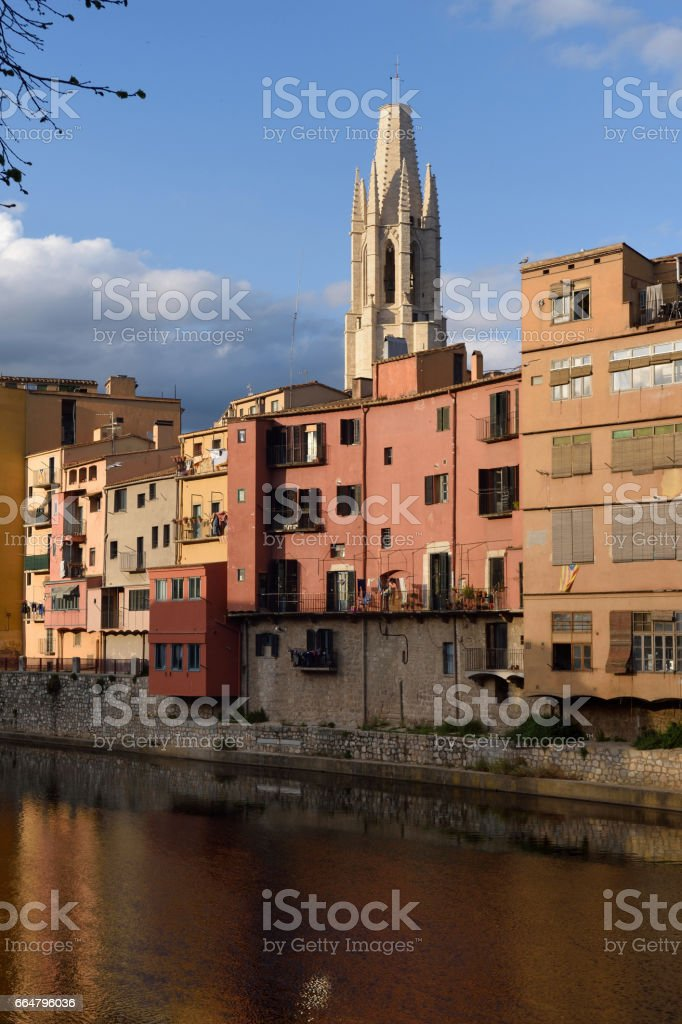 Colorful houses on the river Onyar and church of Sant Feliu, Girona, Catalonia, Spain stock photo