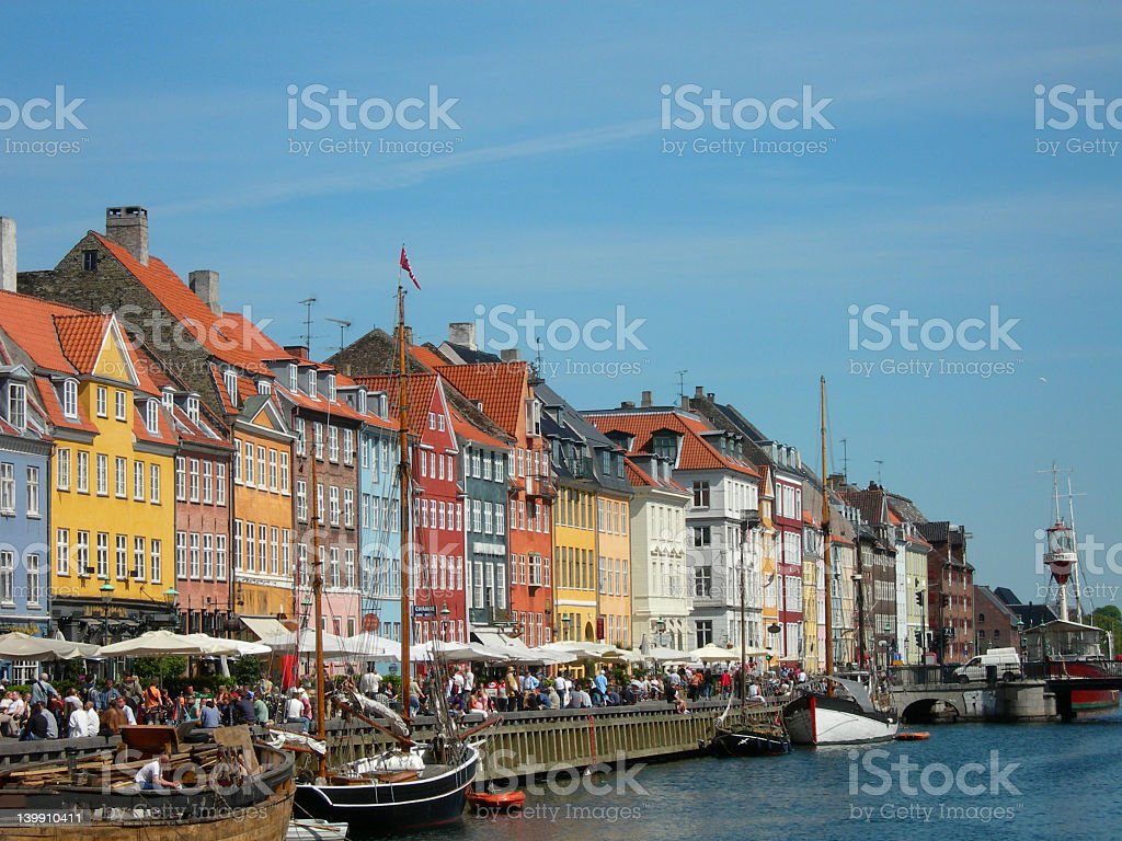 Colorful houses on the waterway of Nyhavn in Copenhagen stock photo