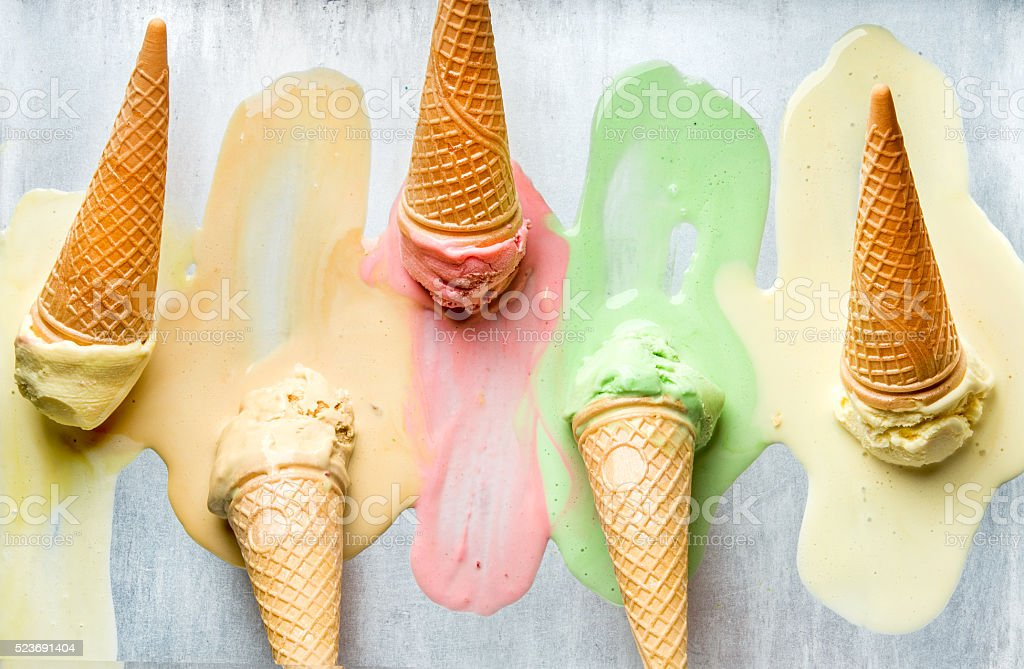 Colorful ice cream cones of different flavors. Melting scoops. Top stock photo