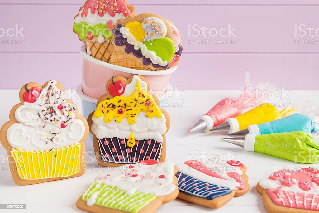 Colorful icing cookies in cupcake shape stock photo
