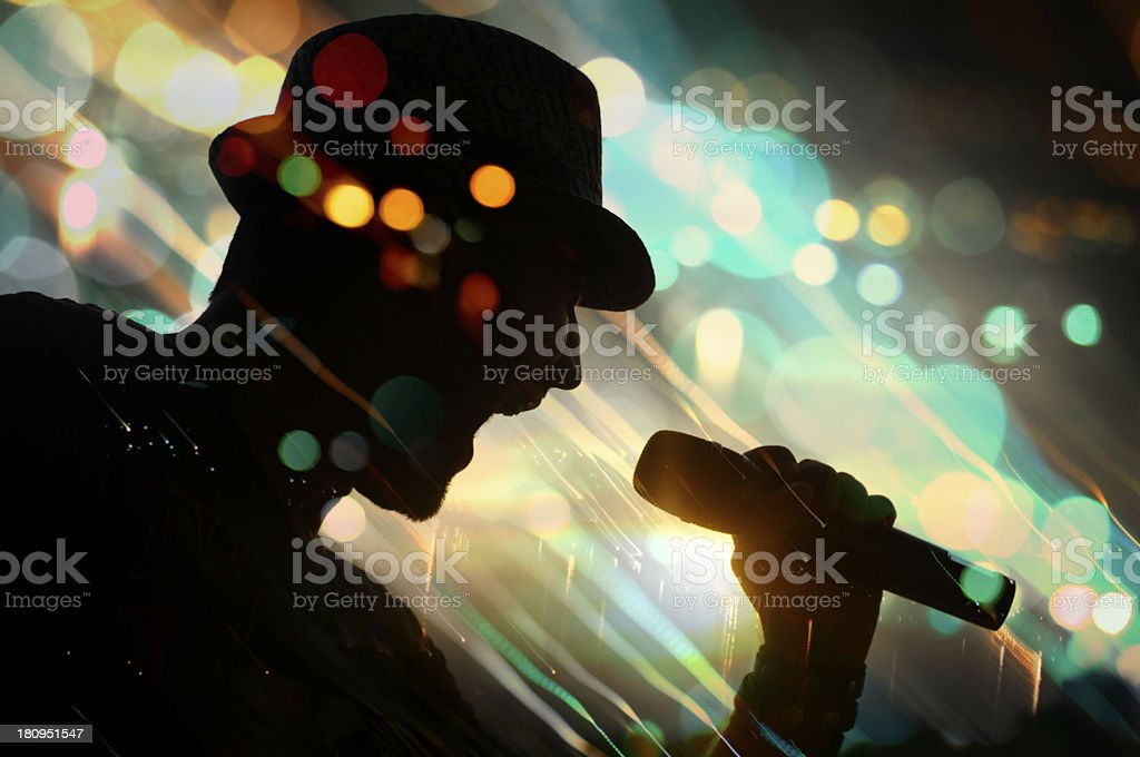 Colorful image of a singer's silhouette in colorful bokeh stock photo