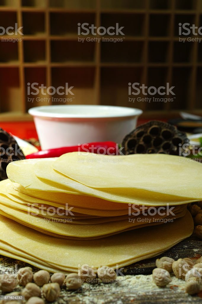 Colorful Indian food  - chickpea, papadum and spices on textured stock photo