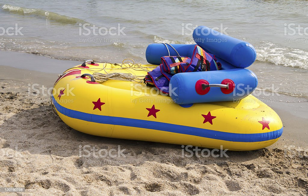Colorful inflatable raft on the beach. royalty-free stock photo