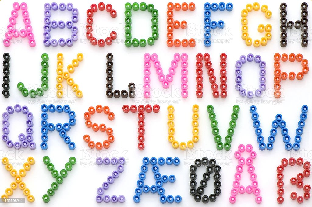 Colorful Iron Beads German Alphabet royalty-free stock photo