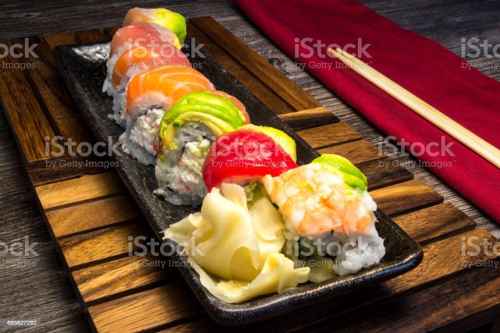 Colorful Japanese Cuisine Sushi And Sashimi On Wood Platter stock photo