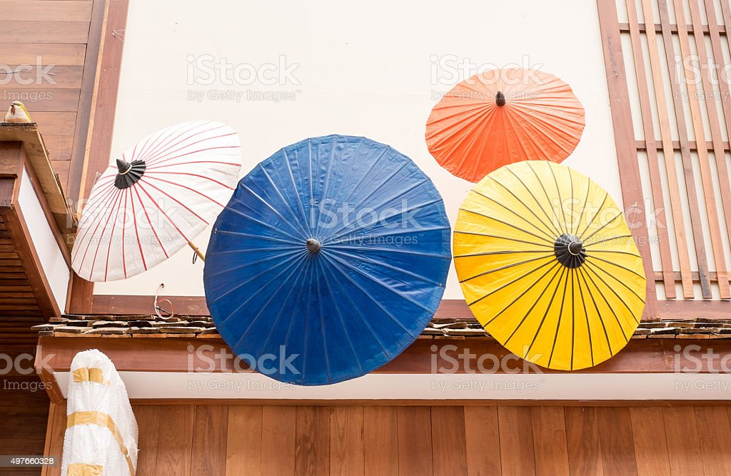 Colorful Japanese umbrella use to decoration infront of shop. stock photo