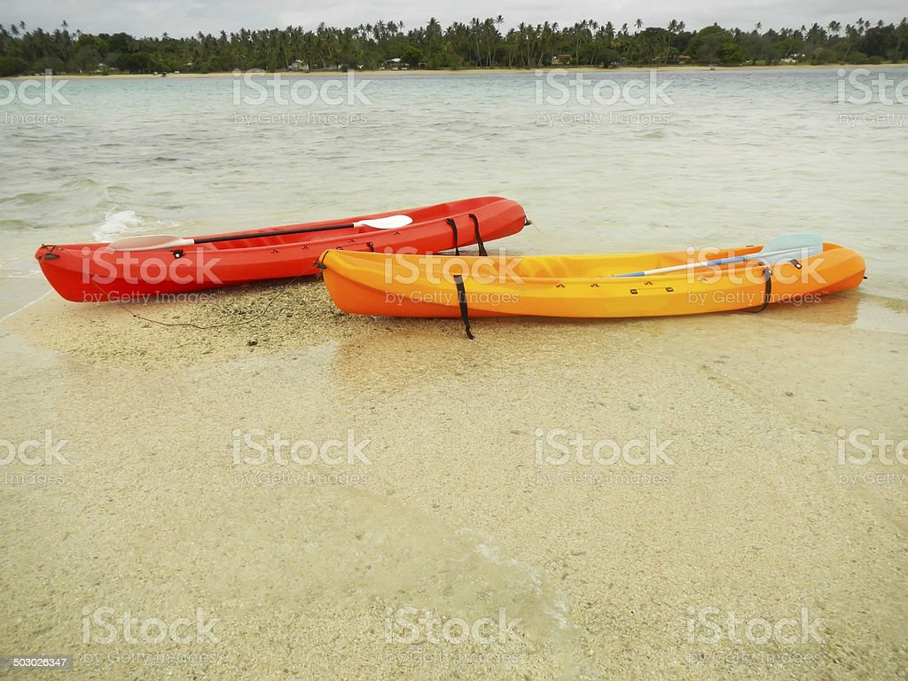 Colorful kayaks in a water, Ofu island, Tonga stock photo
