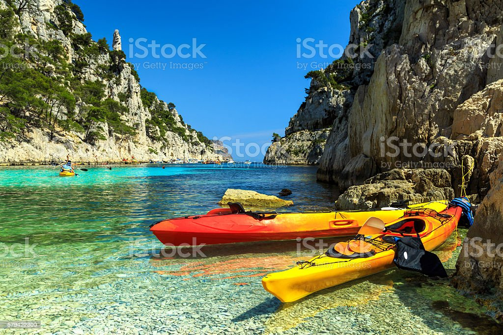 Colorful kayaks in the rocky bay,Cassis,near Marseille,France stock photo