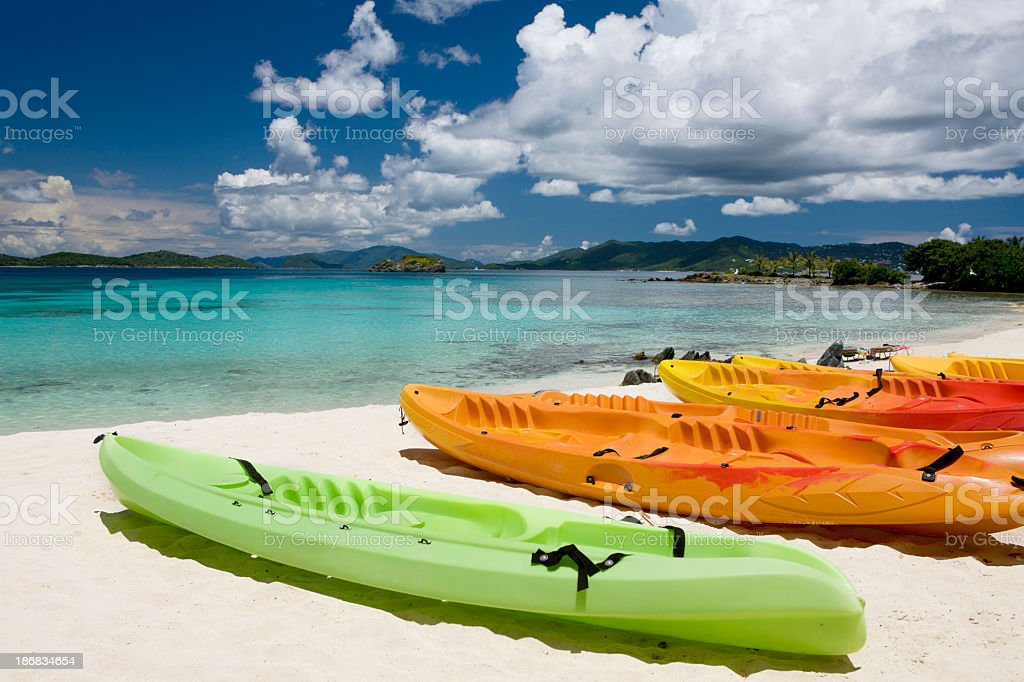 colorful kayaks on a beach in the Virgin Islands royalty-free stock photo