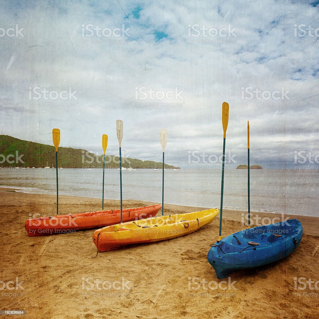 colorful kayaks on a beach royalty-free stock photo