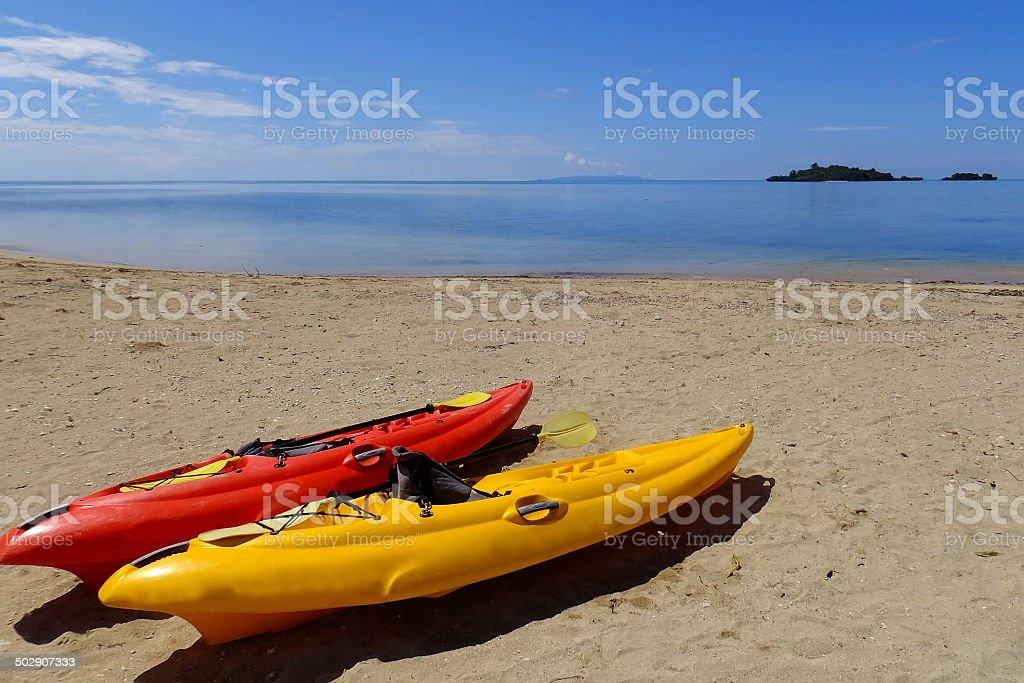 Colorful kayaks on a beach, Vanua Levu island, Fiji stock photo