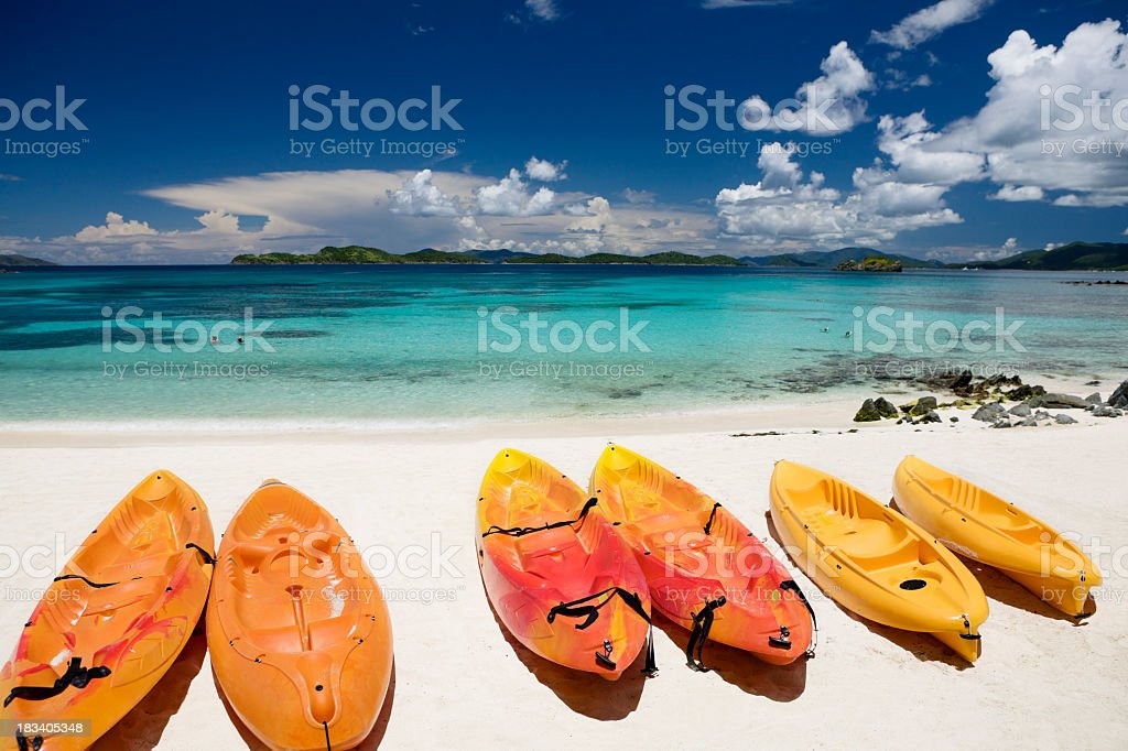 colorful kayaks on a beautiful beach in Virgin Islands royalty-free stock photo