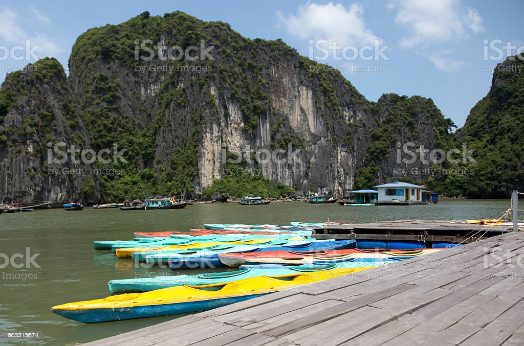 Colorful kayaks on the sea in Ha long bay Vietnam stock photo