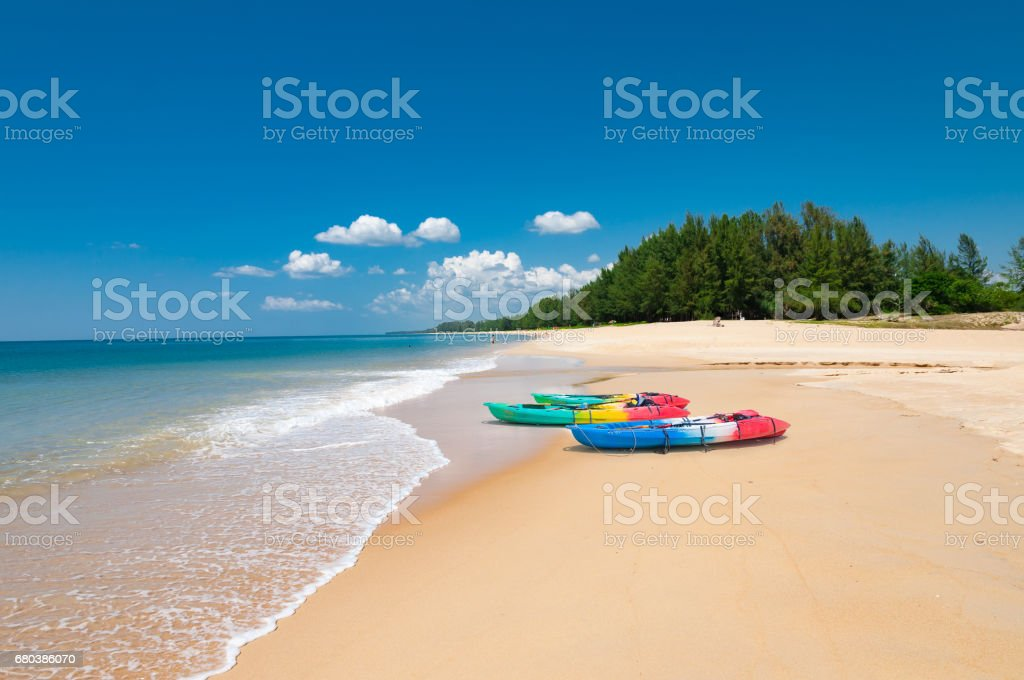 Colorful kayaks on the tropical beach and calm blue sea in Phuket island, Thailand stock photo
