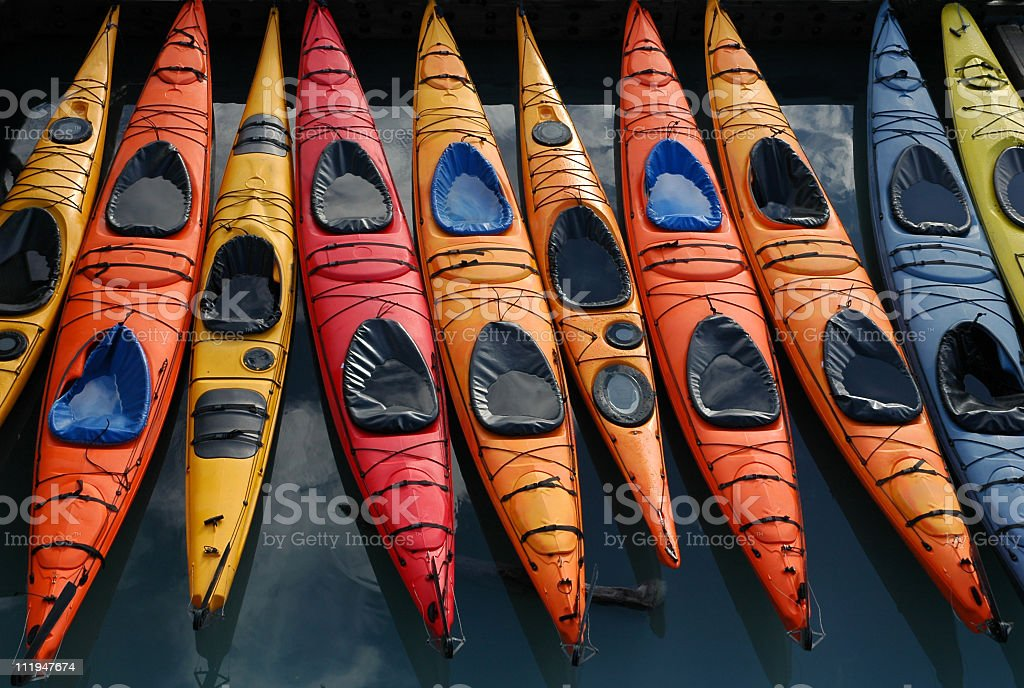 Colorful kayaks waiting for tourists royalty-free stock photo