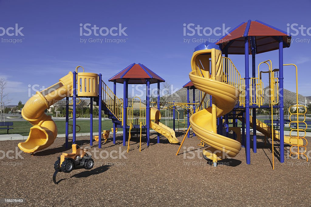 Colorful kids outdoor playground equipment with slides stock photo