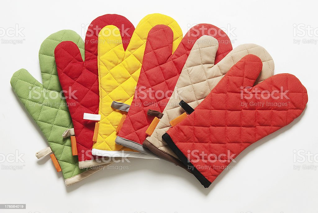 colorful kitchen gloves isolated on white background royalty-free stock photo