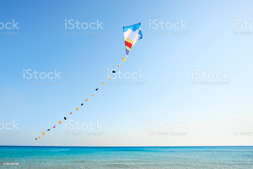colorful kite flying in the wind stock photo