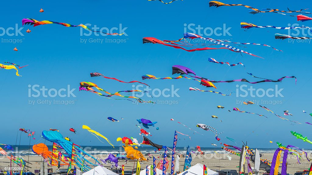 Colorful kites against a blue sky stock photo