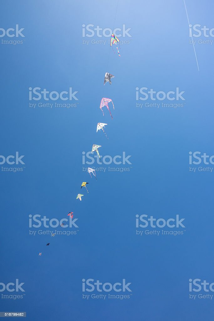 colorful kites flying in the sky stock photo